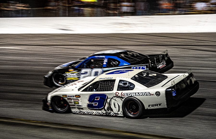 Brad May (9) battles Anthony Sergi during Saturday's Red Eye 50/50 super late model feature at New Smyrna Speedway. (Jason Reasin Photo)