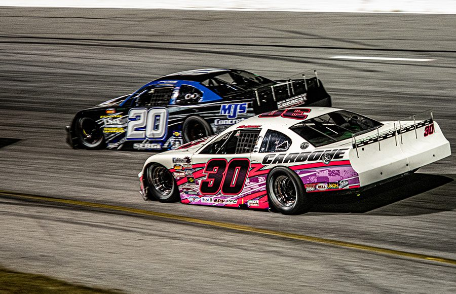 Jesse Dutilly (30) battles Anthony Sergi during Saturday's Red Eye 50/50 super late model feature at New Smyrna Speedway. (Jason Reasin Photo)