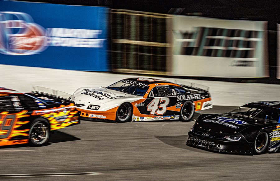 Daniel Dye (43) races in the pack during Saturday's Red Eye 50/50 super late model feature at New Smyrna Speedway. (Jason Reasin Photo)