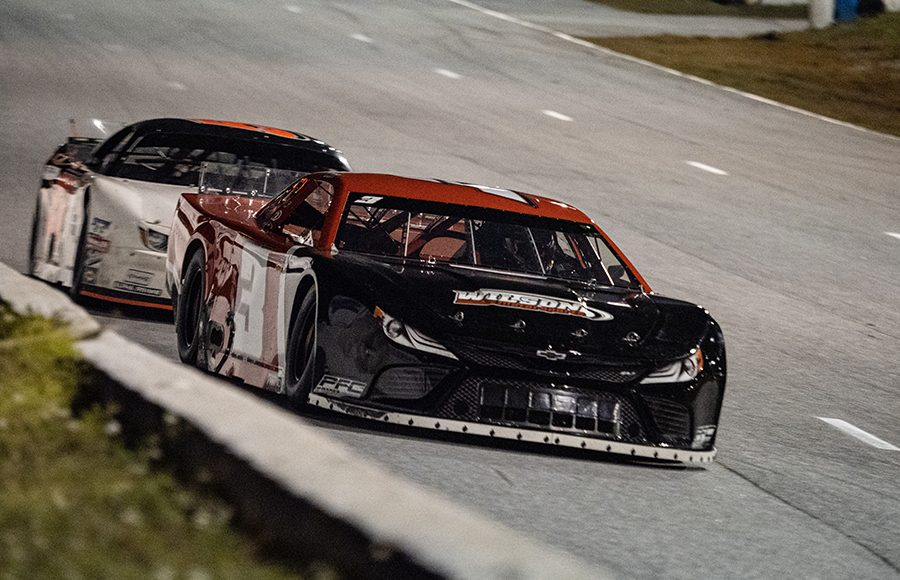 Will Cox (3) races ahead of Mike Skinner during the Red Eye 50/50 pro late model feature Saturday at New Smyrna Speedway. (Jason Reasin Photo)