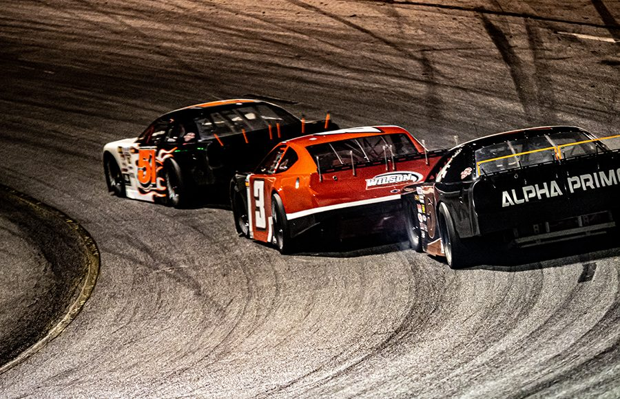Mike Skinner (5) leads a group of cars during the Red Eye 50/50 pro late model feature Saturday at New Smyrna Speedway. (Jason Reasin Photo)