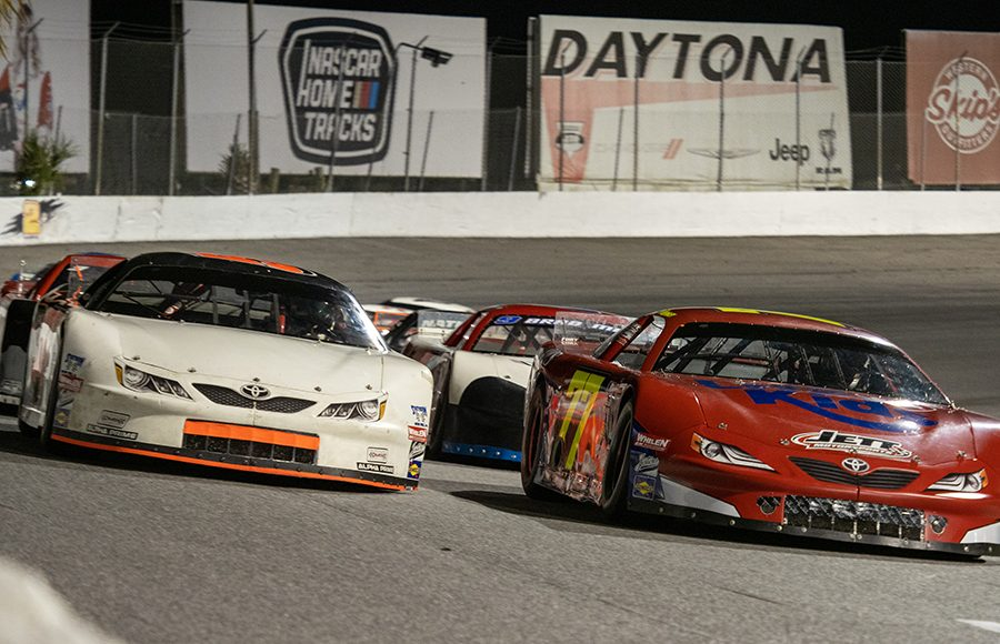 Colt Hensley (77) and Mike Skinner (5) prepare to go racing during the Red Eye 50/50 pro late model feature Saturday at New Smyrna Speedway. (Jason Reasin Photo)
