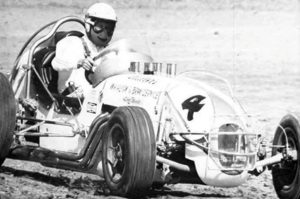 Gordon Woolley hard on the wheel during an IMCA event. (Bob Gates Photo Collection)