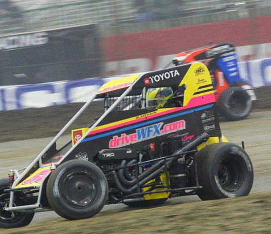 Blake Hahn (52) races under Tyler Courtney during Monday's Chili Bowl Cummins Qualifying Night feature in Tulsa, Okla. (Brendon Bauman photo)