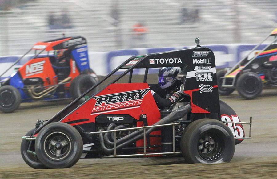Jacob Deeney (35) battles for position in the pack during Monday's Chili Bowl Cummins Qualifying Night feature in Tulsa, Okla. (Brendon Bauman photo)