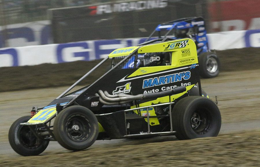 Stephen Schnapf (11) battles his way through the field during Monday's Chili Bowl Cummins Qualifying Night feature in Tulsa, Okla. (Brendon Bauman photo)