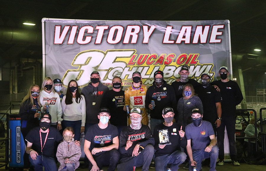 The Keith Kunz Motorsports crew poses in victory lane after Cannon McIntosh's victory in Monday's Chili Bowl Cummins Qualifying Night in Tulsa, Okla. (Brendon Bauman photo)