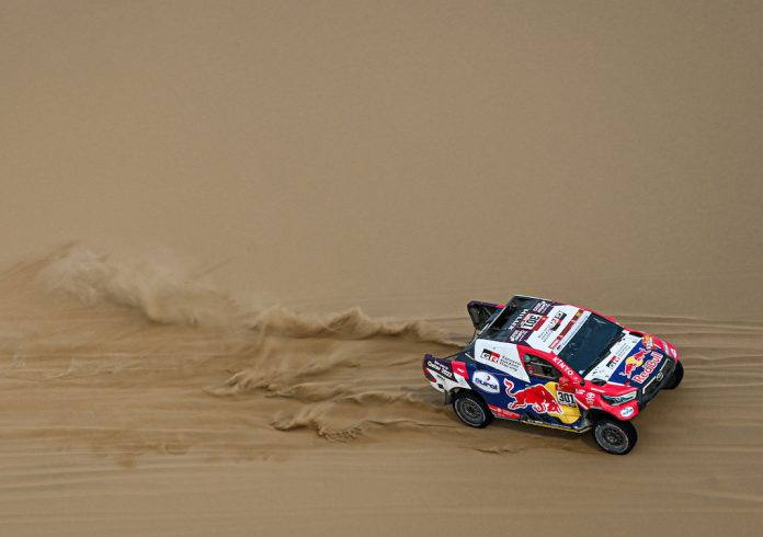 Nasser Al-Attiyah and Matthieu Baumel in the Toyota Hilux of Toyota Gazoo Racing during the 11th stage of the Dakar Rally. (Red Bull Content Pool photo)