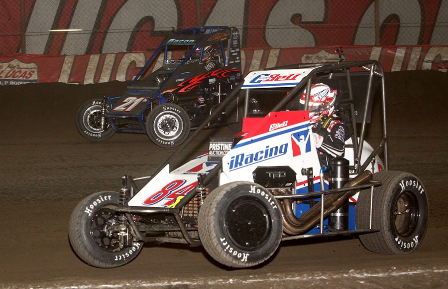 Christopher Bell (84X) battles Brady Bacon during Thursday's Chili Bowl qualifying night feature at Tulsa Expo Raceway. (Richard Bales Photo)