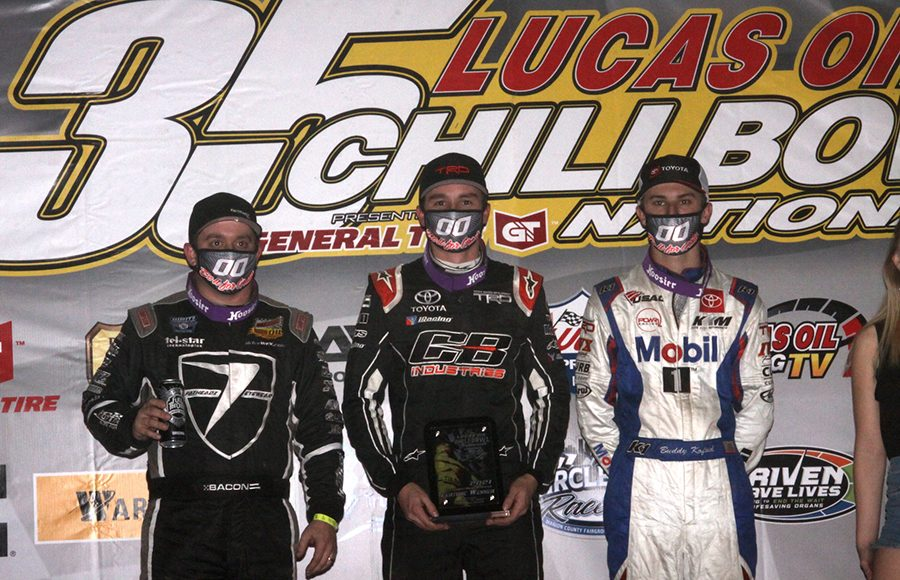 Christopher Bell (center), Buddy Kofoid (right) and Brady Bacon (left) were the top-three finishers in Thursday's Chili Bowl qualifying night feature. (Richard Bales Photo)