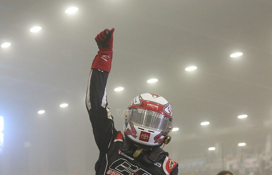 Christopher Bell celebrates after winning Thursday's Chili Bowl qualifying night feature. (Brendon Bauman Photo)