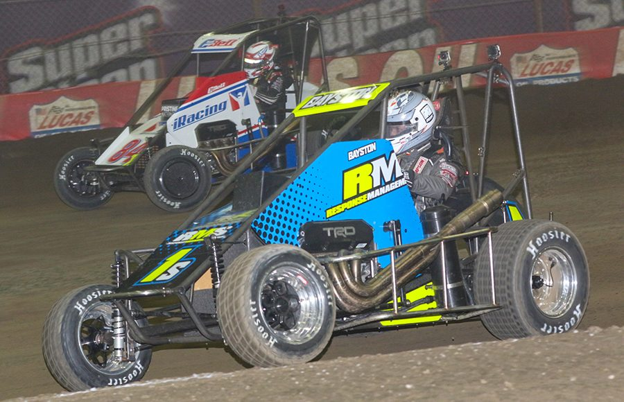 Spencer Bayston (1s) battles alongside Christopher Bell during Thursday's Chili Bowl qualifying event at Tulsa Expo Raceway. (Brendon Bauman Photo)