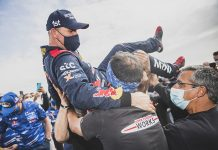 Stephane Peterhansel celebrates after winning his 14th Dakar Rally on Friday. (Red Bull Photo)