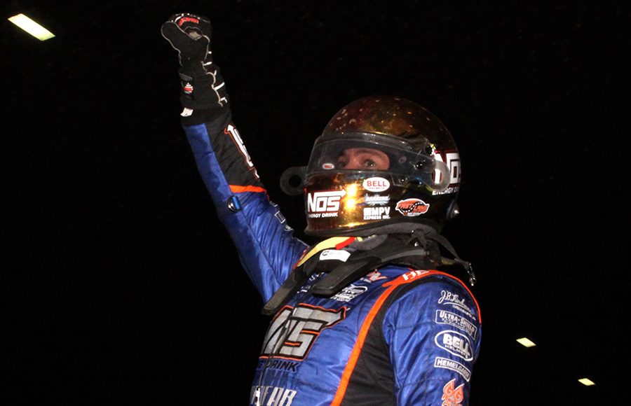 Justin Grant celebrates after winning Friday's Chili Bowl preliminary feature. (Richard Bales Photo)