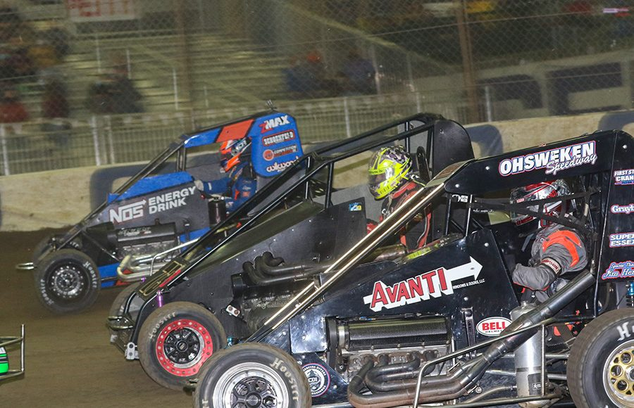 J.J. Yeley (2G), Tyler Edwards (73B) and Ricky Stenhouse Jr. race three-wide during Friday's Chili Bowl preliminary event. (Brendon Bauman Photo)