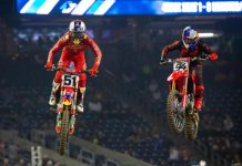 Justin Barcia (51) battles Ken Roczen inside Houston's NRG Stadium. (Feld photo)