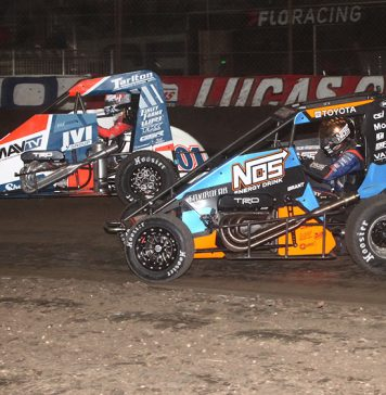 Justin Grant (2) races under Kyle Larson during the Lucas Oil Chili Bowl Nationals finale Saturday in Tulsa, Okla. (Richard Bales Photo)