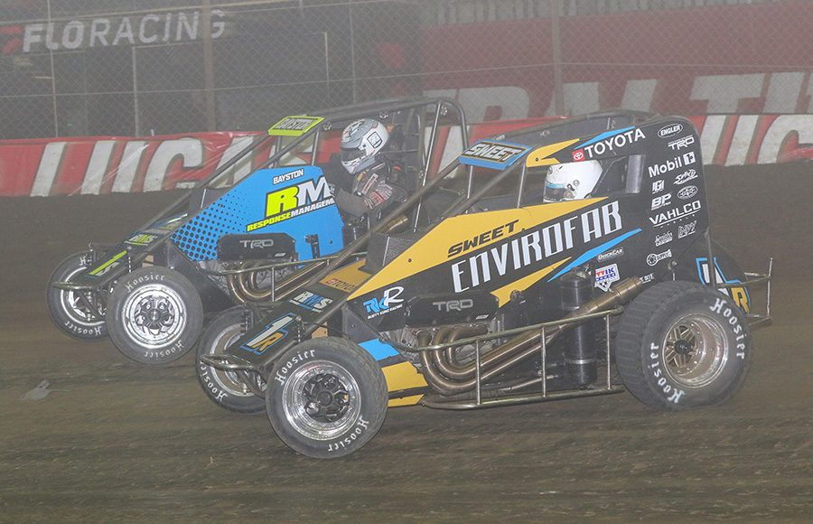 Brad Sweet (1R) battles Spencer Bayston during the Lucas Oil Chili Bowl Nationals on Saturday night. (Brendon Bauman Photo)