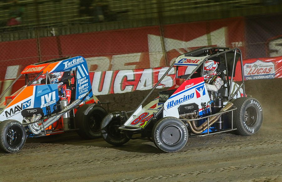 Christopher Bell (84) battles Kyle Larson for the race lead during Saturday's Lucas Oil Chili Bowl Nationals finale. (Brendon Bauman Photo)