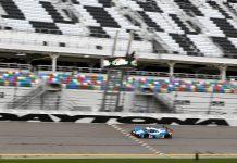 The Muehlner Motorsports America machine wheeled by Moritz Kranz and Laurents Hoerr takes the checkered flag at Daytona Int'l Speedway. (IMSA photo)