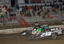 Kevin Adams (40) leads Jason Hughes to the checkered flag at East Bay Raceway Park. (Jim DenHamer photo)