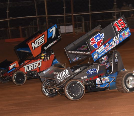 Donny Schatz (15) charges under Tyler Courtney at Screven Motor Speedway. (Paul Arch photo)