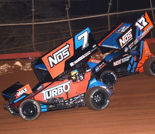 Tyler Courtney (7) battles Sheldon Haudenschild during Friday's Ollie's Bargain Outlet All Star Circuit of Champions event at Screven Motorsports Park. (Paul Arch Photo)