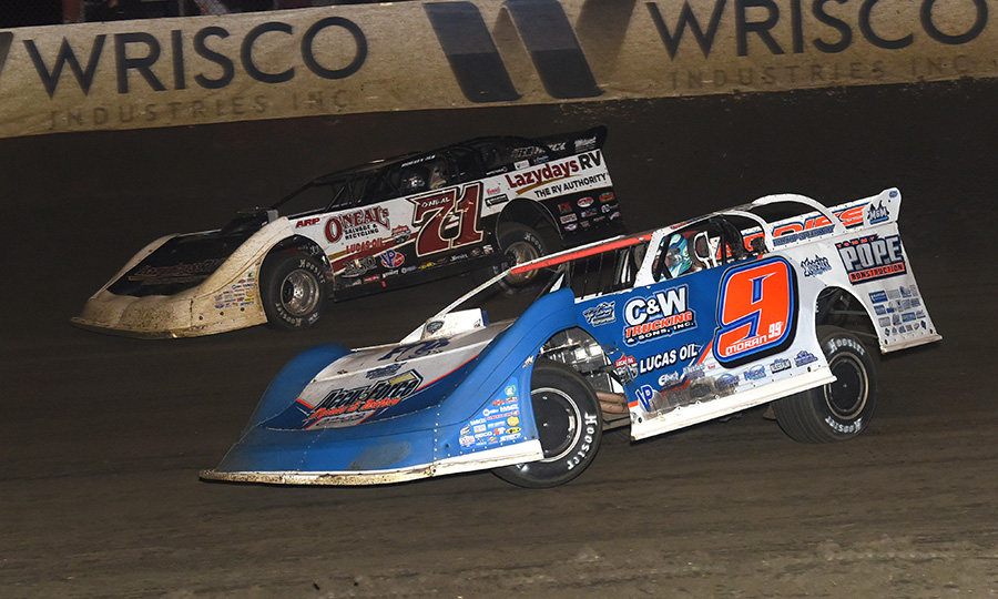 Devin Moran (9) races under Hudson O'Neal during Saturday's Lucas Oil Late Model Dirt Series race at East Bay Raceway Park. (Paul Arch Photo)