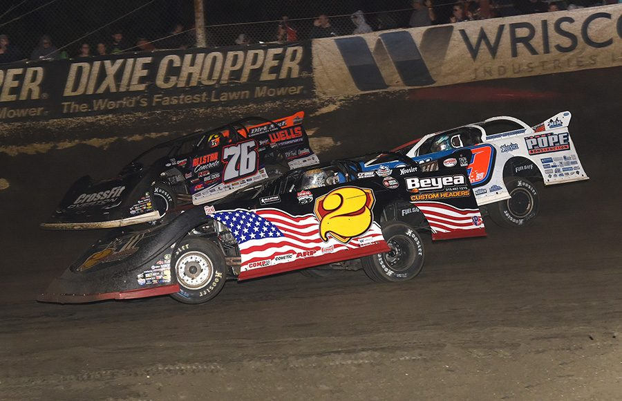 Dan Stone (2), Devin Moran (9) and Brandon Overton battle for position during Saturday's Lucas Oil Late Model Dirt Series race at East Bay Raceway Park. (Paul Arch Photo)