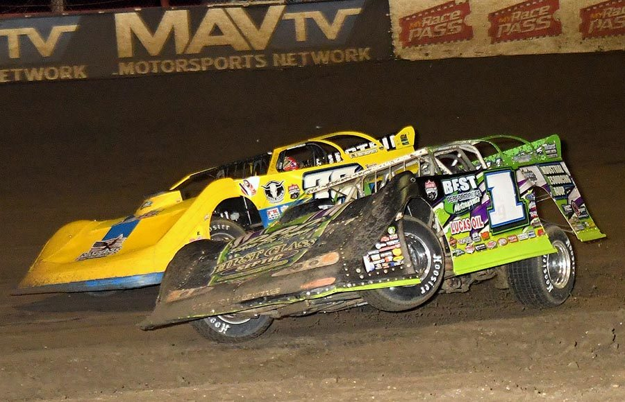 Tyler Erb (1) kicks a tire off the ground while battling Tim McCreadie during Friday's Lucas Oil Late Model Dirt Series event at East Bay Raceway Park. (Hein Brothers Photo)