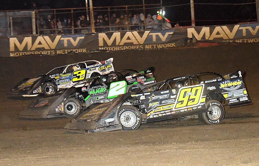 Frank Heckenast Jr. (99), Stormy Scott (2) and Brian Shirley race for position during Saturday's Lucas Oil Late Model Dirt Series event at East Bay Raceway Park. (Hein Brothers Photo)