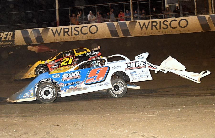 Devin Moran (9) works his damaged late model under the car of Billy Moyer Jr. during Saturday's Lucas Oil Late Model Dirt Series event at East Bay Raceway Park. (Hein Brothers Photo)