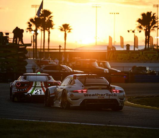 Cars race into the sunset during the 59th Rolex 24 at Daytona Int'l Speedway. (IMSA photo)