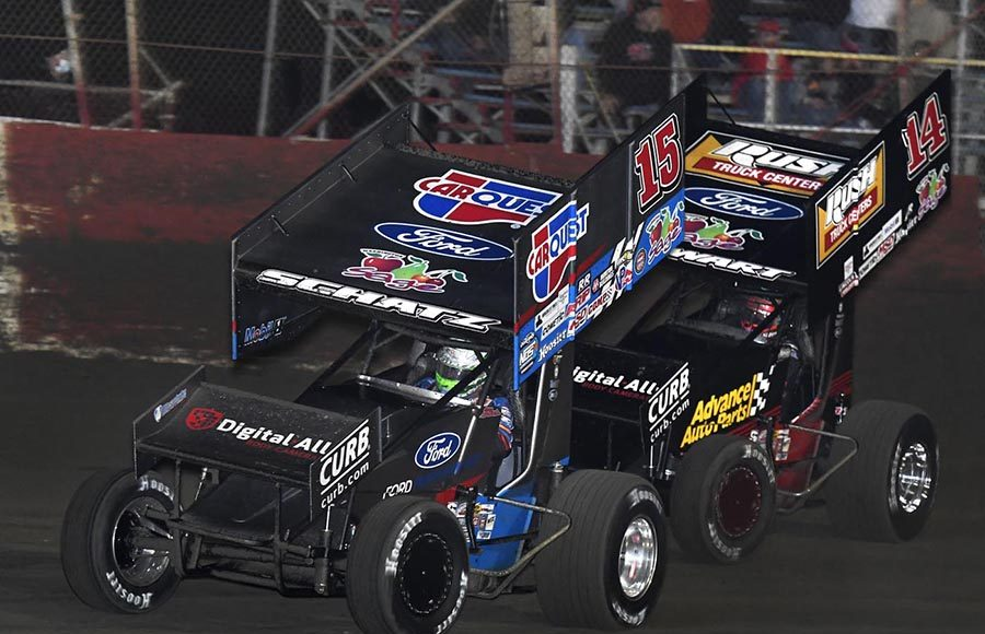 Donny Schatz (15) battles team owner and teammate Tony Stewart during Tuesday's Ollie's Bargain Outlet All Star Circuit of Champions feature at East Bay Raceway Park. (Frank Smith Photo)
