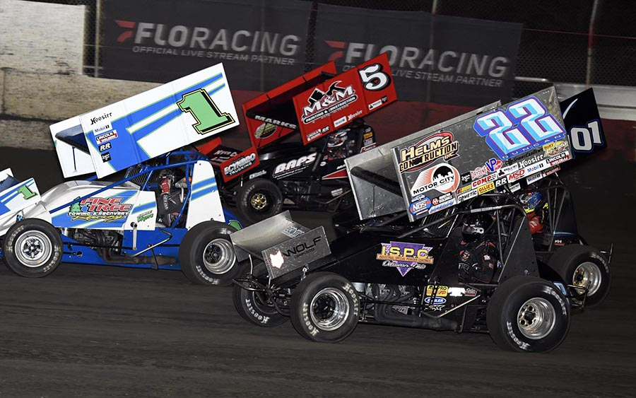 Cole Duncan (22), Kerry Madsen (101), Jamie Myers (1) and Brent Marks battle for position during Tuesday's Ollie's Bargain Outlet All Star Circuit of Champions feature at East Bay Raceway Park. (Frank Smith Photo)