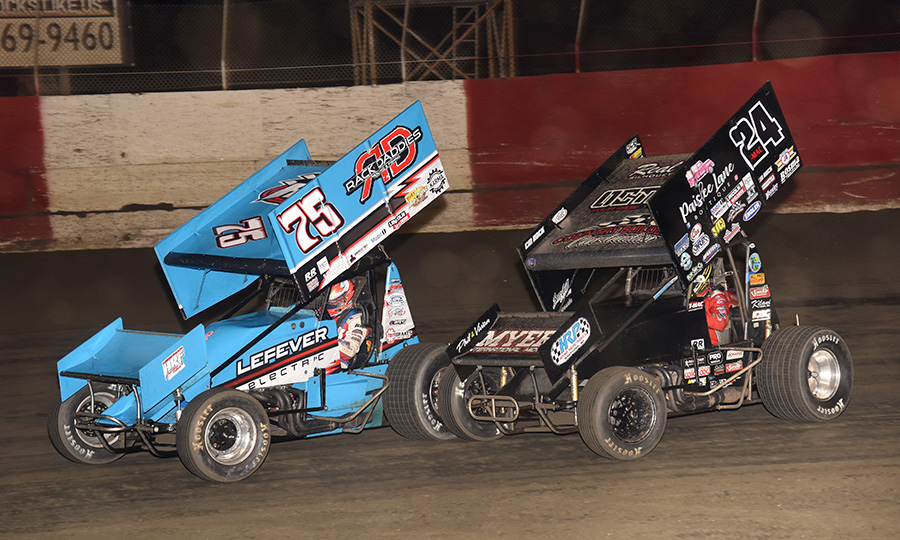 Tyler Ross (75) races ahead of Terry McCarl during Tuesday's Ollie's Bargain Outlet All Star Circuit of Champions feature at East Bay Raceway Park. (Paul Arch Photo)