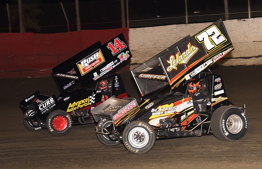 Tim Shaffer (72) races alongside Tony Stewart during Tuesday's Ollie's Bargain Outlet All Star Circuit of Champions feature at East Bay Raceway Park. (Paul Arch Photo)