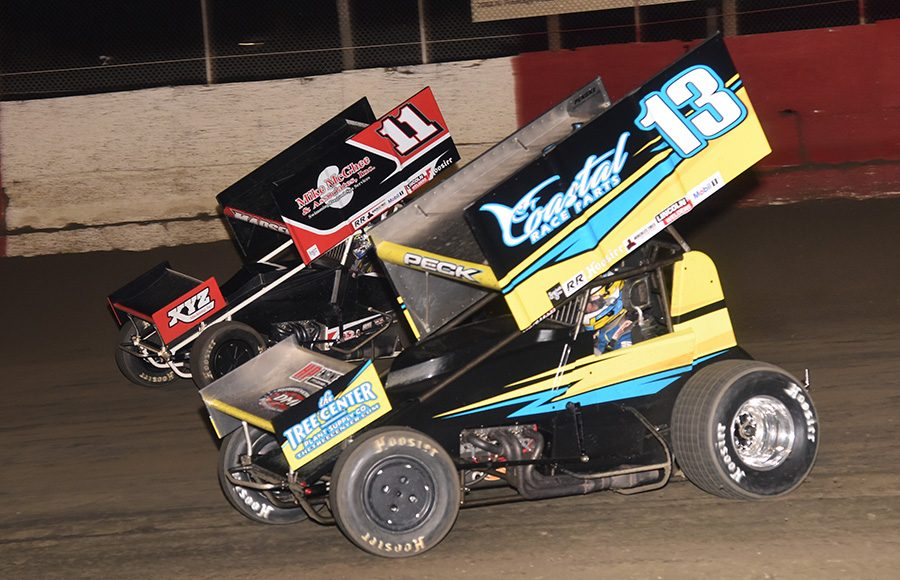 Justin Peck (13) races alongside Ian Madsen during Tuesday's Ollie's Bargain Outlet All Star Circuit of Champions feature at East Bay Raceway Park. (Paul Arch Photo)
