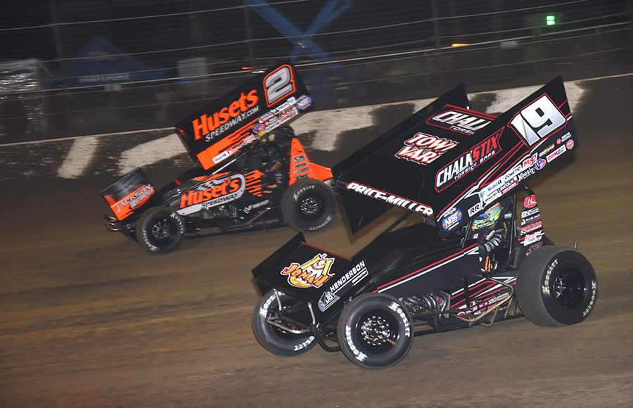 Parker Price-Miller (19) battles David Gravel during Wednesday's Ollie's Bargain Outlet All Star Circuit of Champions event at Volusia Speedway Park. (Paul Arch Photo)