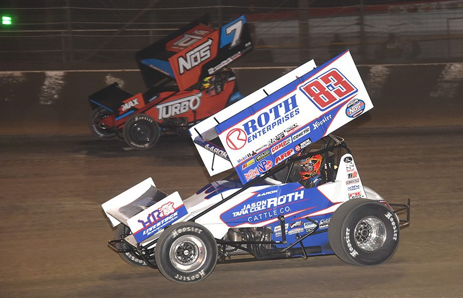 Aaron Reutzel (83) works his way under Tyler Courtney during Wednesday's Ollie's Bargain Outlet All Star Circuit of Champions event at Volusia Speedway Park. (Paul Arch Photo)