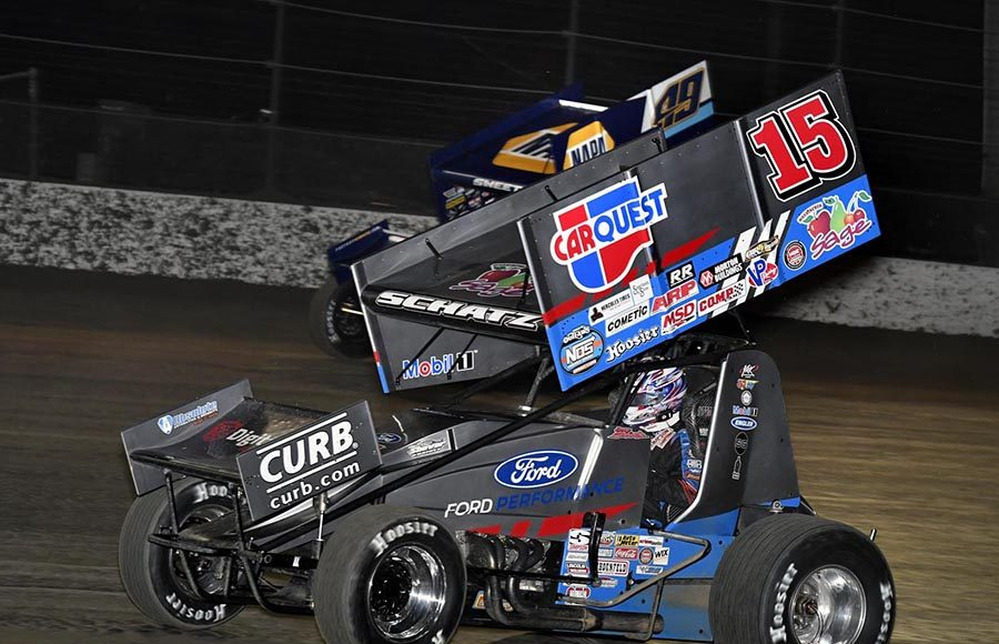Donny Schatz (15) races under Brad Sweet during Wednesday's Ollie's Bargain Outlet All Star Circuit of Champions event at Volusia Speedway Park. (Frank Smith Photo)