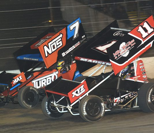 Ian Madsen (11) battles Tyler Courtney during Thursday's All Star Circuit of Champions event at Volusia Speedway Park. (Paul Arch Photo)