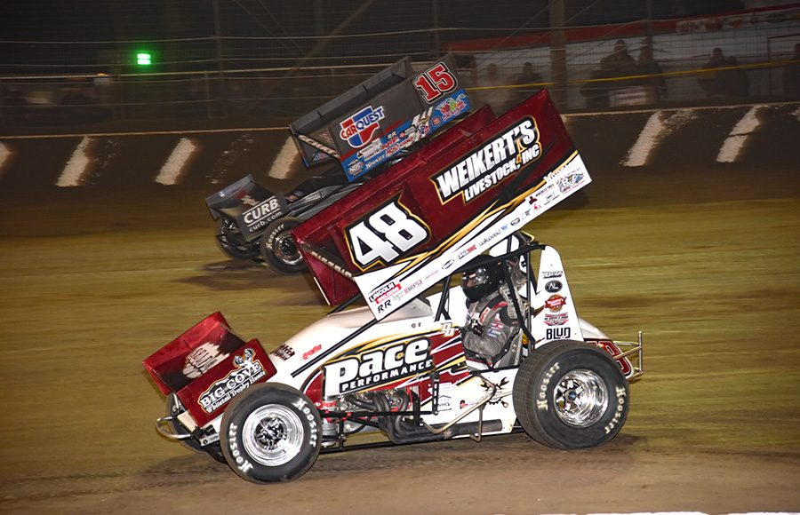 Danny Dietrich (48) races under Donny Schatz during Thursday's All Star Circuit of Champions event at Volusia Speedway Park. (Paul Arch Photo)