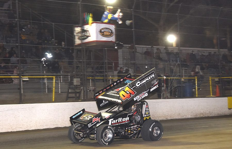 Carson Macedo takes the checkered flag to win Thursday's All Star Circuit of Champions feature at Volusia Speedway Park. (Paul Arch Photo)
