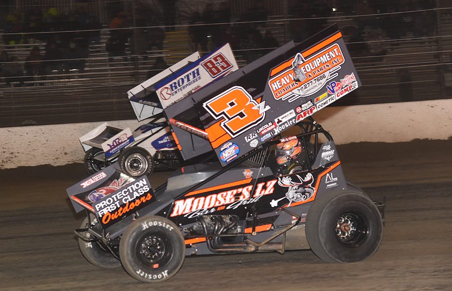 Brock Zearfoss (3z) and Aaron Reutzel battle for position during Thursday's All Star Circuit of Champions event at Volusia Speedway Park. (Paul Arch Photo)