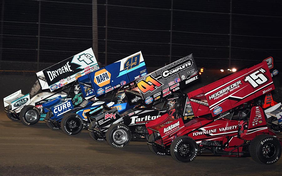 The field for Friday's World of Outlaws NOS Energy Drink Sprint Car Series race prepares to go racing at Volusia Speedway Park. (Frank Smith Photo)