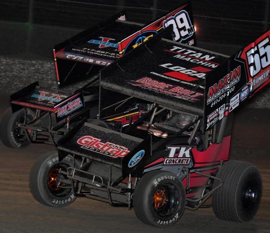 Hunter Schuerenberg (55) battles Anthony Macri during Friday's World of Outlaws NOS Energy Drink Sprint Car Series feature at Volusia Speedway Park. (Frank Smith Photo)