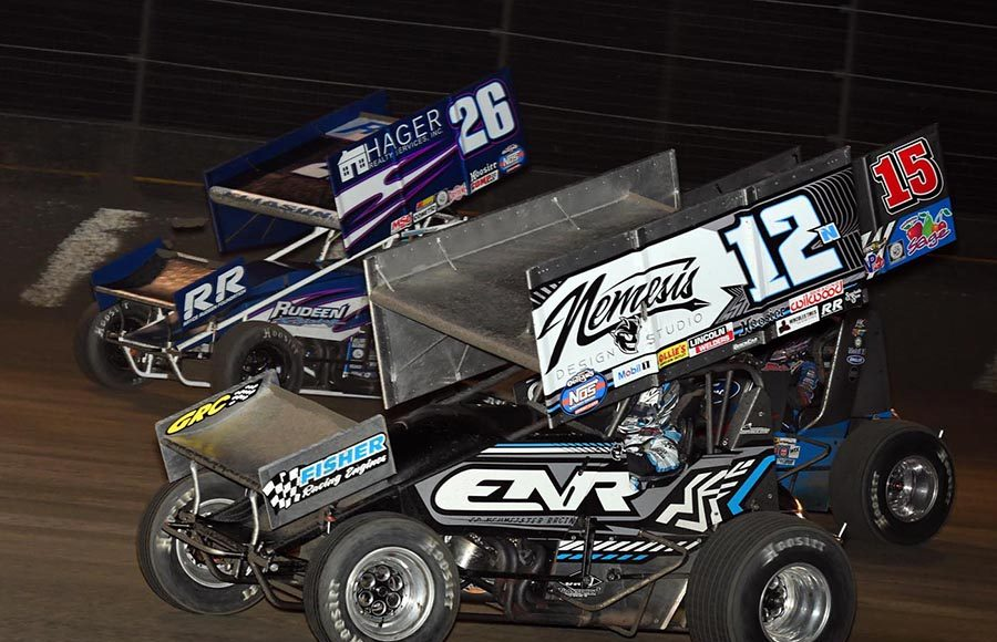 Joey Saldana (12n), Donny Schatz (15) and Cory Eliason battle for position during Friday's World of Outlaws NOS Energy Drink Sprint Car Series feature at Volusia Speedway Park. (Frank Smith Photo)