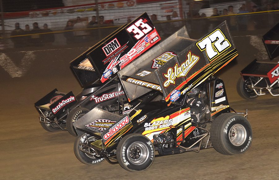 Tim Shaffer (72) races under Mason Daniel during Friday's World of Outlaws NOS Energy Drink Sprint Car Series feature at Volusia Speedway Park. (Paul Arch Photo)