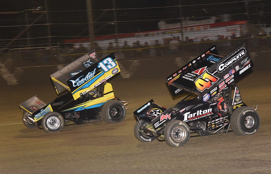 Justin Peck (13) races under Carson Macedo during Friday's World of Outlaws NOS Energy Drink Sprint Car Series feature at Volusia Speedway Park. (Paul Arch Photo)